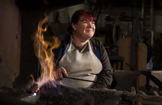 NatWestA female steel worker sat by a forge ©Getty Images